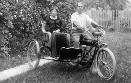 [Alfred T. Layne on motorcycle with elderly lady in sidecar]