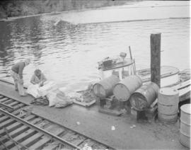 [Men on dock at] Pacific Mills [on the] Queen Charlotte Islands
