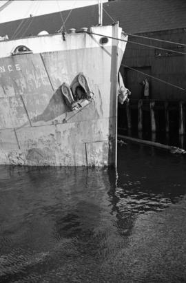 [The bow of a freighter at dock]