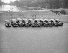 [Vancouver News Agency drivers standing in front of a row of delivery trucks by Lost Lagoon at St...