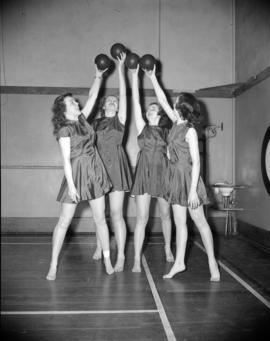[Women posing with balls for Pro-Rec fitness centres]