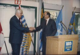 Patrick Reid shaking hands with Mike Harcourt