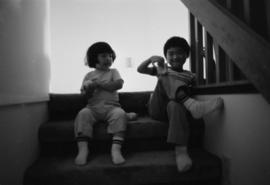 Two young children on a staircase