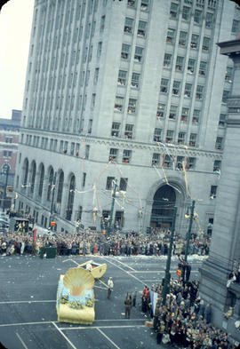 43rd Grey Cup Parade, on Granville Street and Hastings, Shell float turning, spectators and Royal...