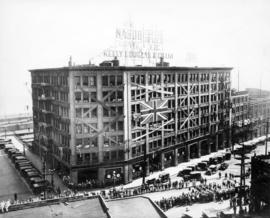 "[H.M.S. ""Hood"" sailors on parade in front of the Kelly, Douglas and Co. Ltd. building 3..."