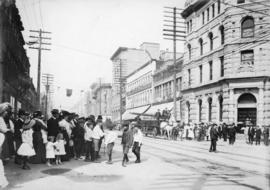 [People observing parade at Hastings and Richards Streets]