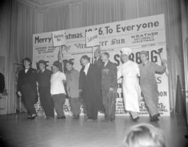 [Board of Trade members doing a skit at a Christmas party]