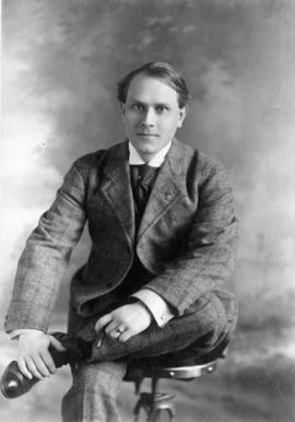 [Portrait; Alfred T. Layne, actor in tweed suit, holding cigar]