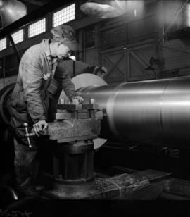 [Man working on a large pipe at Vancouver Engineering Works]