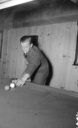 [Man playing pool at the Burrard Servicemen's Centre, 636 Burrard Street]