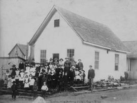 [Group assembled on steps of Hastings Sawmill School]