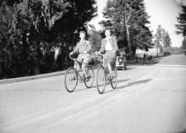 [Two cyclists near entrance to Stanley Park]