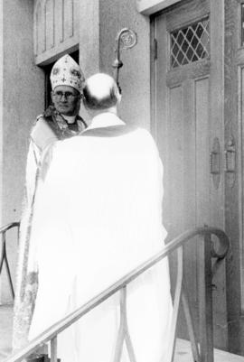 [Archbishop A.U. De Pencier awaits admittance to St. James' Church for the consecration]