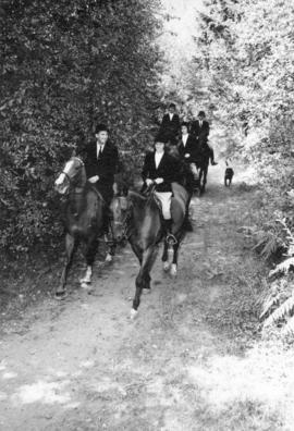 [A group on a trail ride]