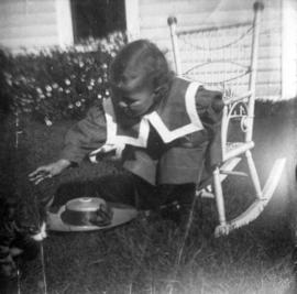 [Theodore Taylor sitting in rocking chair in yard of home at Willow Street and 8th Avenue in Fair...