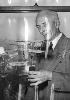[William Templeton with the model airplane that Mr. Frank H. Ellis built in 1911]
