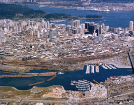 Aerial view of Downtown Vancouver and False Creek, with Fairview, Stanley Park, Cambie Street Bri...