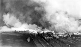 [Pier D and C.P.R. sheds demolished by fire with smoke enveloping waterfront]