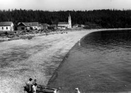 [View along the beach on Sechelt Band lands looking towards Our Lady of Lourdes Church]