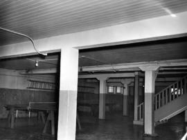 Interior of Fairview High School of Commerce, ping pong tables in basement