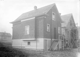 [Rear view of houses in Grandview-Cedar Cottage area]
