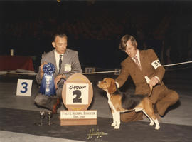 Group two (Hound Group) award being presented by judge H.J. Brunotte at 1973 P.N.E. All-Breed Dog...