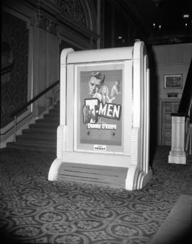 "[Movie poster for ""T-Men"" starring Denis O'Keefe in the lobby of the Orpheum]"