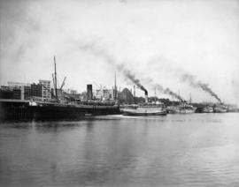[View from the water of ships and docks east of the second C.P.R. Station]