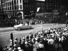 Car and marching girls in 1952 P.N.E. Opening Day Parade