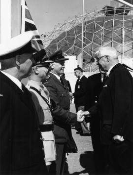 Lieutenant Governor G.R. Pearkes with officers at Armed Forces of Canada exhibit on P.N.E. grounds