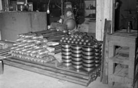 [Large bolts and other metal components stacked at Vancouver Engineering Works]