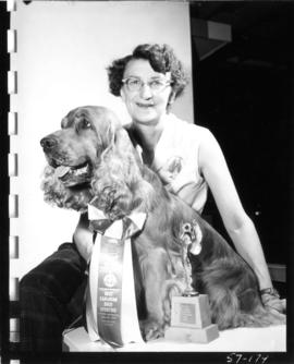 Woman with award-winning entry [Cocker spaniel?] in 1957 P.N.E. All-Breed Dog Show