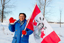 Day 71 Woman with First Nations flag in Long Plain, Manitoba.