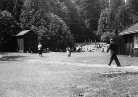 People and shed at Lumberman's Arch picnic area at Stanley Park