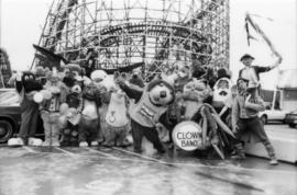 Group of mascots in front of roller coaster at PNE grounds