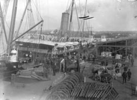 [Ships, workers, and cargo at C.P.R. dock, Vancouver]