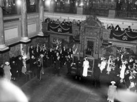 [King George VI and Queen Elizabeth greet people in the Legislative Chamber]
