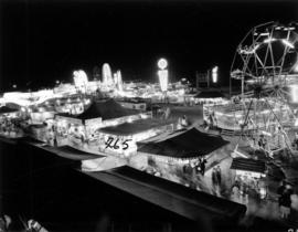 Illuminated P.N.E. Gayway amusement rides and tents at night