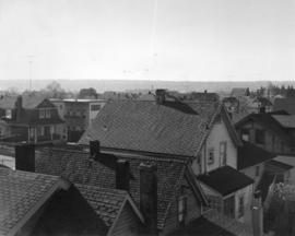 [View looking west showing the back of houses in the 2100 block 6th Ave West and a house and apar...