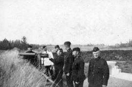 [Officers of the 2nd Battalion, 5th Regiment, Canadian Garrison Artillery practice firing a Maxin...