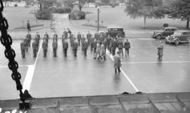 [Air cadets being reviewed in front of the C.N.R. Station by Thornton Park]