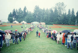 Crowds lined up on field at the Centennial Commission's Canada Day celebrations