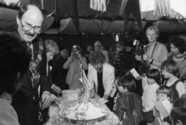 Mike Harcourt beside birthday cake