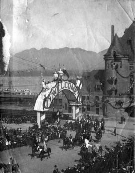 "C.P.R. Station ""Welcome"" arch and procession of Duke and Duchess of Cornwall and York a..."
