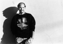 Portrait of unidentified man wearing Gay Games sweatshirt
