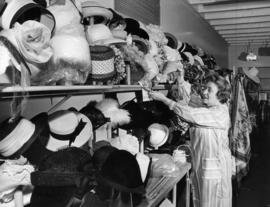 Woman arranging hats for sale to raise funds for Pearson Hospital patients