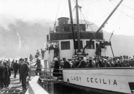 "[Passengers disembarking from S.S. ""Lady Cecilia"" at unidentified dock]"