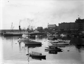 "Inner harbour [showing] small boats and Union Steamship's ""Camosun"""