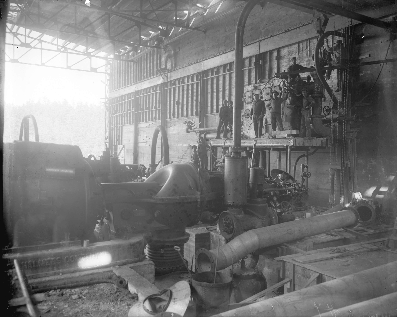 Men assembling turbo generator unit in Brentwood Bay Steam Plant