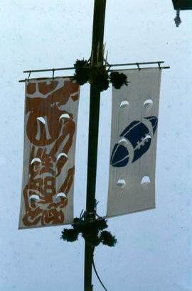 [Football-themed street banners]